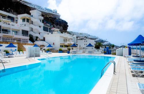 Bb apartamentos puerto rico la playa de arguineguin spain overview - Apartamentos en playa san juan tenerife ...