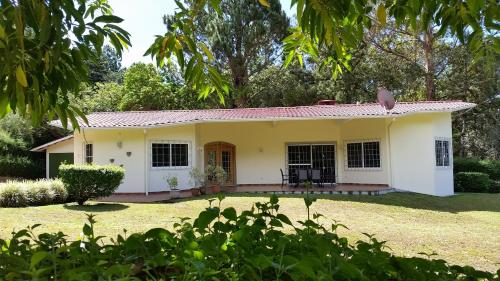 Las Plumas Holiday Home Rentals, Paso Ancho