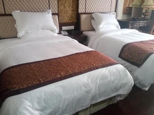Wanning Qiaolong Hotel