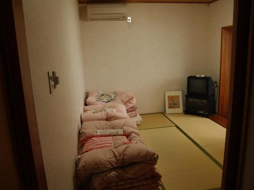 Single Futon in Japanese-Style 4-Bed Male Dormitory Room